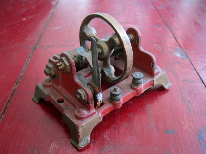 antique cast iron toy motor, flamingsteel.com, steel sculpture, steel art, roy mackey, live work studios