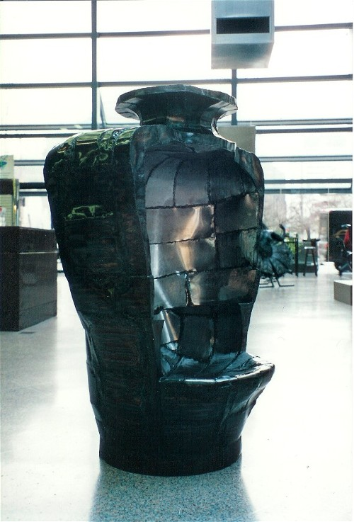 Bottle Chair steel sculpture by Roy Mackey