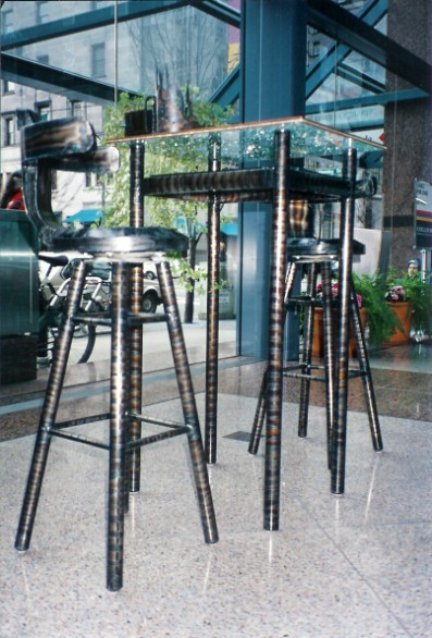 Bar stool and table, Hongkong bank show vancouver bc, steel sculpture, metal sculpture, roy mackey, flamingsteel.com