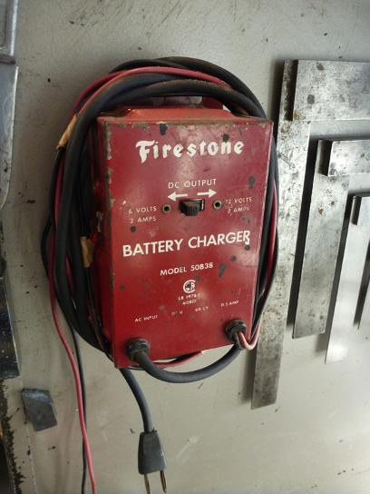 vintage firestone battery charger, flamingsteel.com, steel sculpture, roy mackey